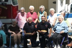 Fire and Rescue holding fresh baked pies