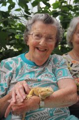 Margret happily holds the Bearded Dragon